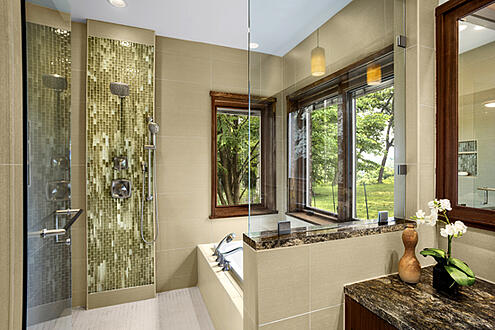 master bath design includes glass tile in shower